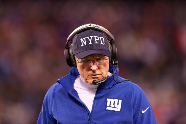 New York Giants head coach Tom Coughlin reacts while wearing a NYPD cap against the Philadelphia Eagles. (Brad Penner-USA TODAY Sports)