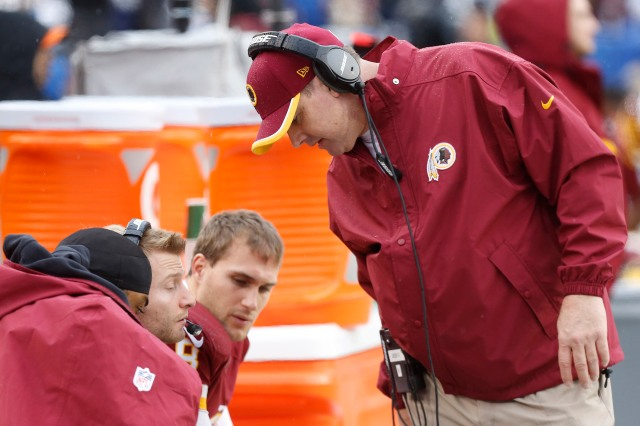 Washington Redskins head coach Jay Gruden (right) talks to Redskins quarterback Robert Griffin III (left) on the bench against the Dallas Cowboys. (Geoff Burke-USA TODAY Sports)
