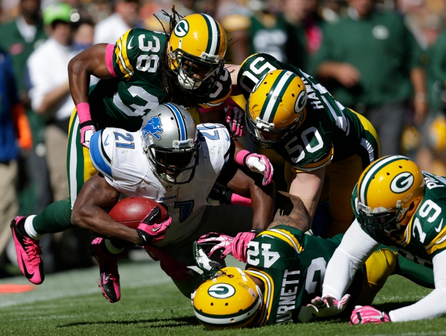The Packers hope to swarm Reggie Bush's Lions for the NFC North crown Sunday afternoon. (Dan Powers, Post-Crescent Media )