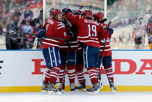 Washington Capitals player congratulate Alex Ovechkin over his first-period goal. (Geoff Burke, USA TODAY Sports)