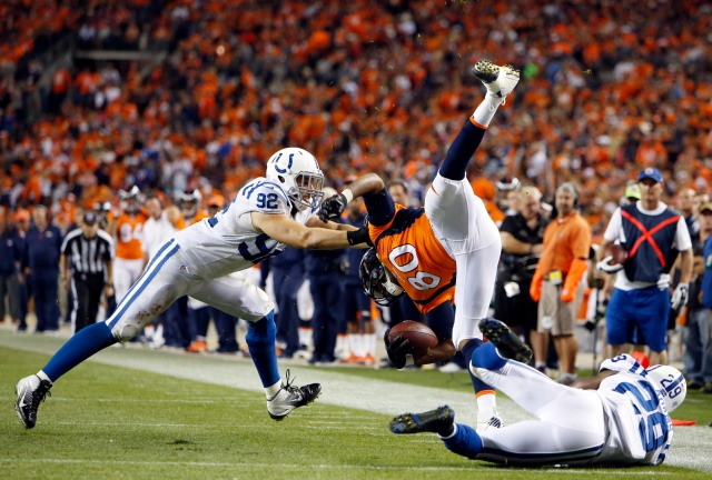 Denver Broncos tight end Julius Thomas (80) is tackled after making a catch by  Indianapolis Colts linebacker Bjoern Werner (92) and safety Mike Adams (29) in Week 1. (Chris Humphreys-USA TODAY Sports)