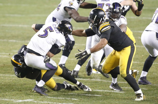 Pittsburgh Steelers inside linebacker Lawrence Timmons (94) and defensive end Cameron Heyward (right) sack Baltimore Ravens quarterback Joe Flacco. (Charles LeClaire-USA TODAY Sports)