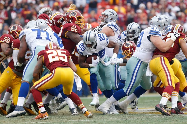 Dallas Cowboys running back DeMarco Murray (29) carries the ball as Washington Redskins free safety Ryan Clark (25) defends. (Geoff Burke-USA TODAY Sports)