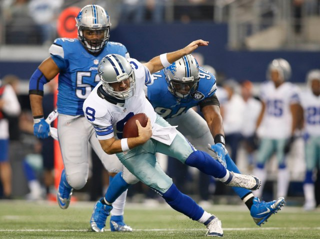 Dallas Cowboys quarterback Tony Romo (9) tries to escape the pressure by Detroit Lions defensive end Ezekiel Ansah (94) and Darryl Tapp (52). (Tim Heitman-USA TODAY Sports)