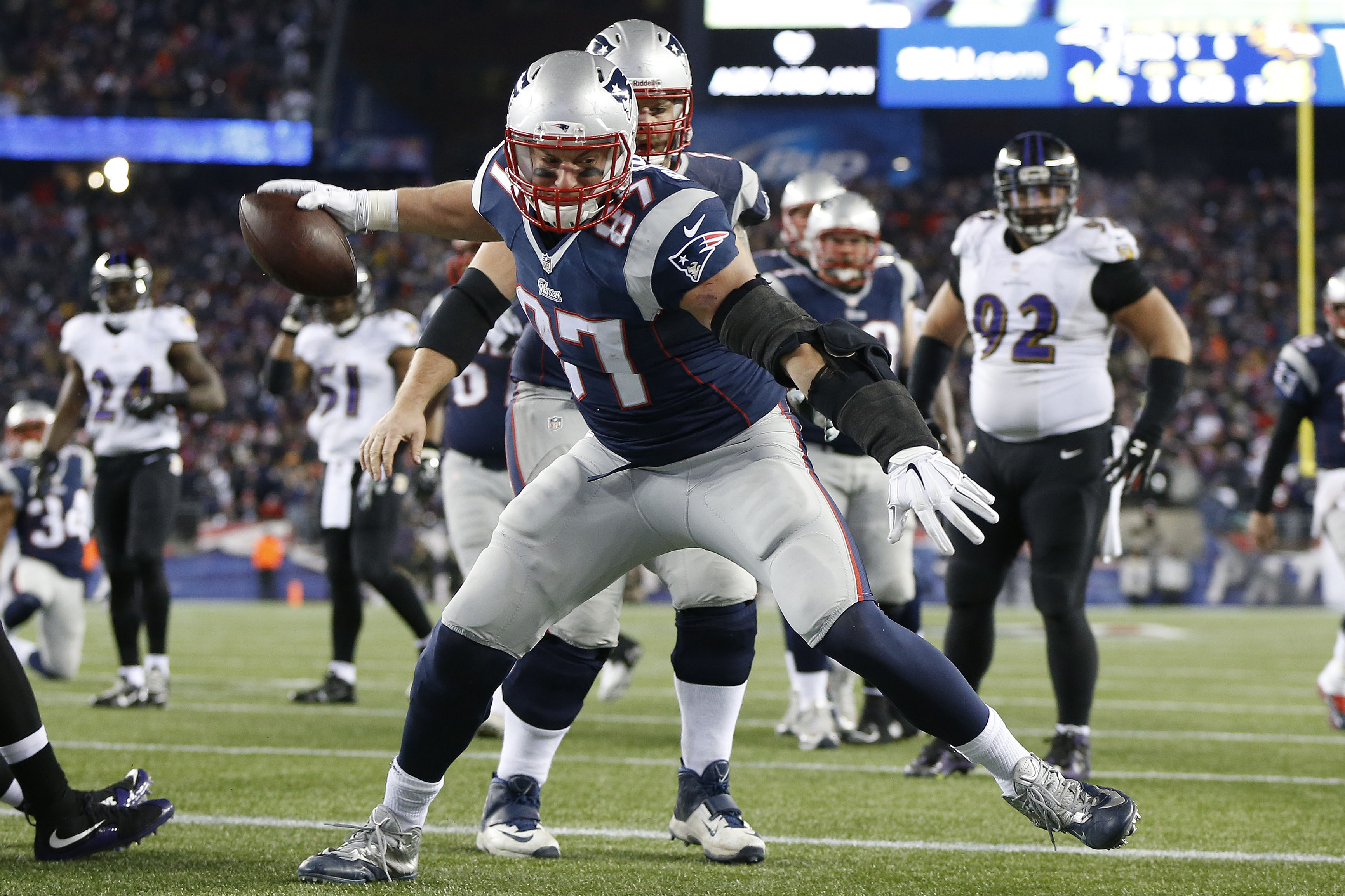Rob Gronkowski (87) celebrates after scoring a touchdown in the third quarter against the Baltimore Ravens during the 2014 AFC Divisional playoff football game at Gillette Stadium. (Greg M. Cooper-USA TODAY Sports)