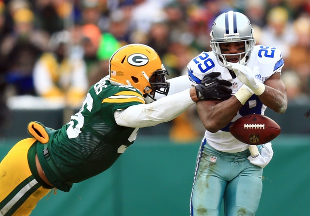 Julius Peppers stretches to knock the ball away from DeMarco Murray. (Andrew Weber-USA TODAY Sports)