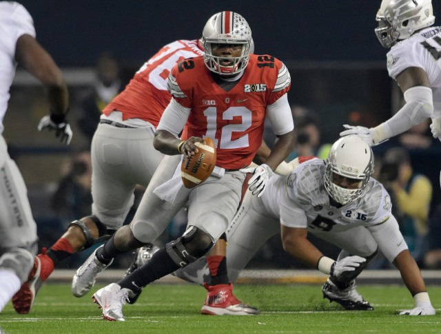 Ohio State Buckeyes quarterback Cardale Jones (12)  runs the ball during the first quarter against the Oregon Ducks in the 2015 CFP National Championship Game. (Kirby Lee-USA TODAY Sports)