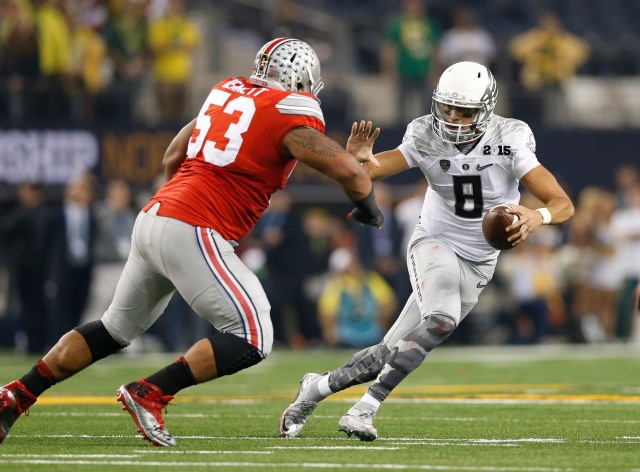 There are too many questions about Marcus Mariota, shown here in the national title game, to make him the top pick. (Matthew Emmons, USA TODAY Sports)
