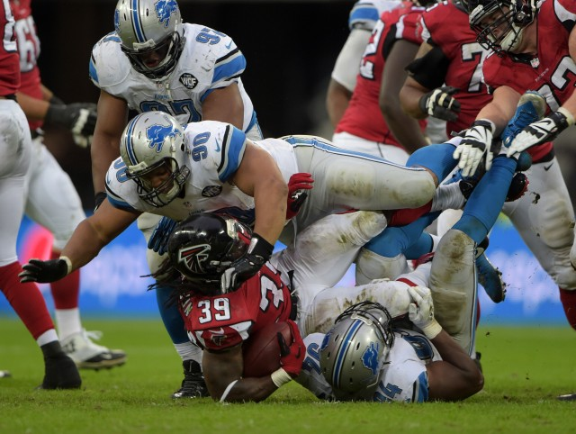 Detroit Lions defensive tackle Ndamukong Suh (90) and defensive end Ezekiel Ansah (94) tackle Atlanta Falcons running back Steven Jackson (39) in the NFL International Series game at Wembley Stadium. (Kirby Lee-USA TODAY Sports)