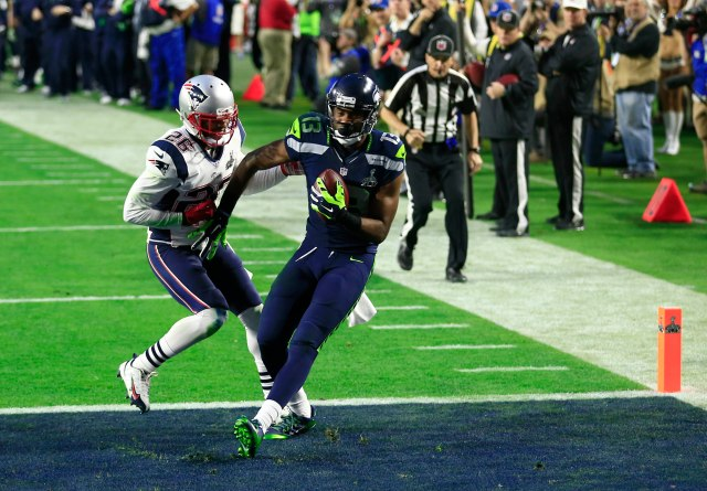 Seattle Seahawks wide receiver Chris Matthews (13) catches a touchdown pass defended by New England Patriots cornerback Logan Ryan (26) during the second quarter in Super Bowl XLIX at University of Phoenix Stadium. Mandatory Credit: Andrew Weber-USA TODAY Sports