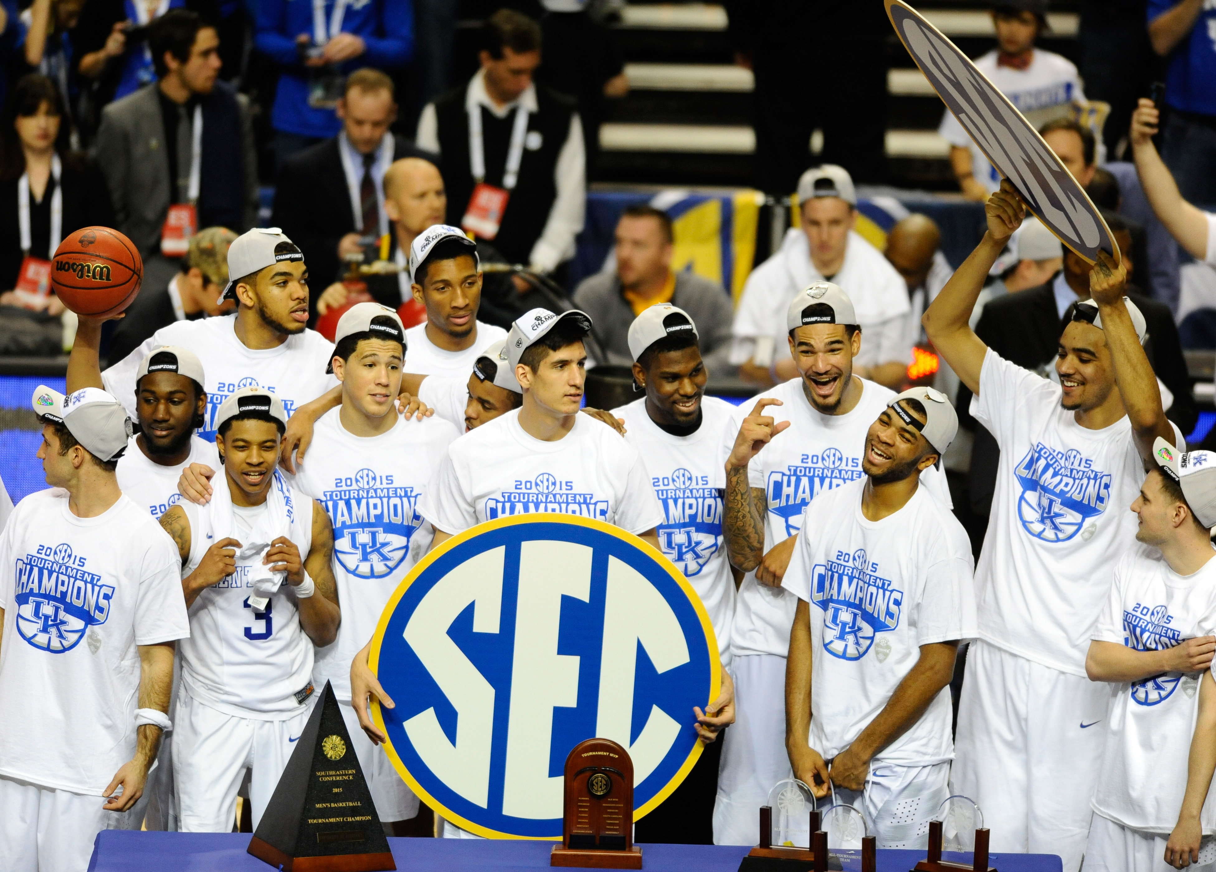 Kentucky Wildcats players celebrate after a win in the SEC Conference Championship game. (Christopher Hanewinckel-USA TODAY Sports)