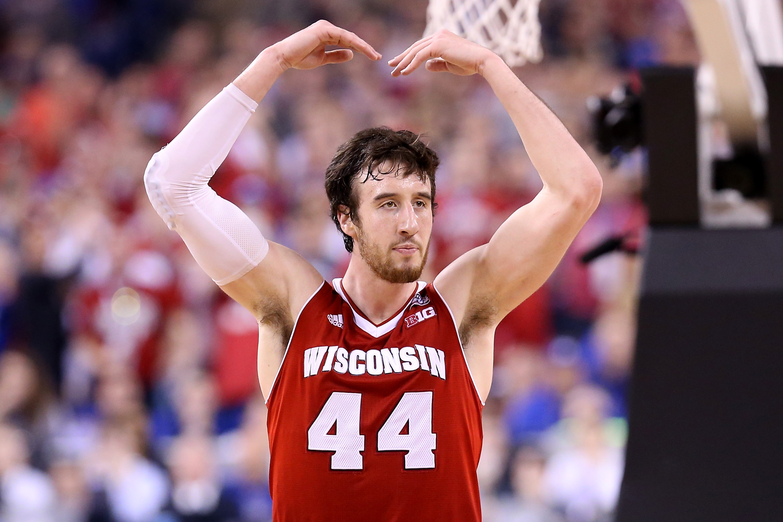 INDIANAPOLIS, IN - APRIL 06: Frank Kaminsky #44 of the Wisconsin Badgers reacts after a play in the second half against the Duke Blue Devils during the NCAA Men's Final Four National Championship at Lucas Oil Stadium on April 6, 2015 in Indianapolis, Indiana.  (Photo by Streeter Lecka/Getty Images) ORG XMIT: 527066925 ORIG FILE ID: 468767788