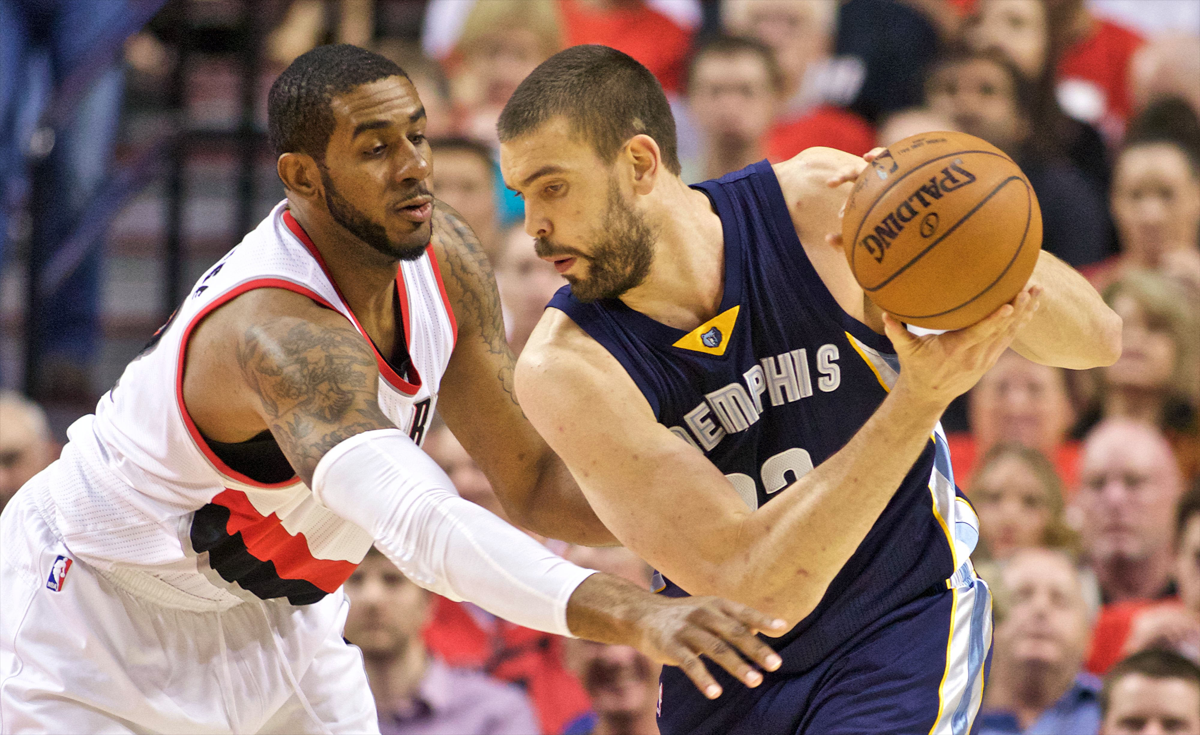 Apr 27, 2015; Portland, OR, USA; Memphis Grizzlies center Marc Gasol (33) posts up against Portland Trail Blazers forward LaMarcus Aldridge (12) during the first quarter in game four of the first round of the NBA Playoffs at the Moda Center. Mandatory Credit: Craig Mitchelldyer-USA TODAY Sports