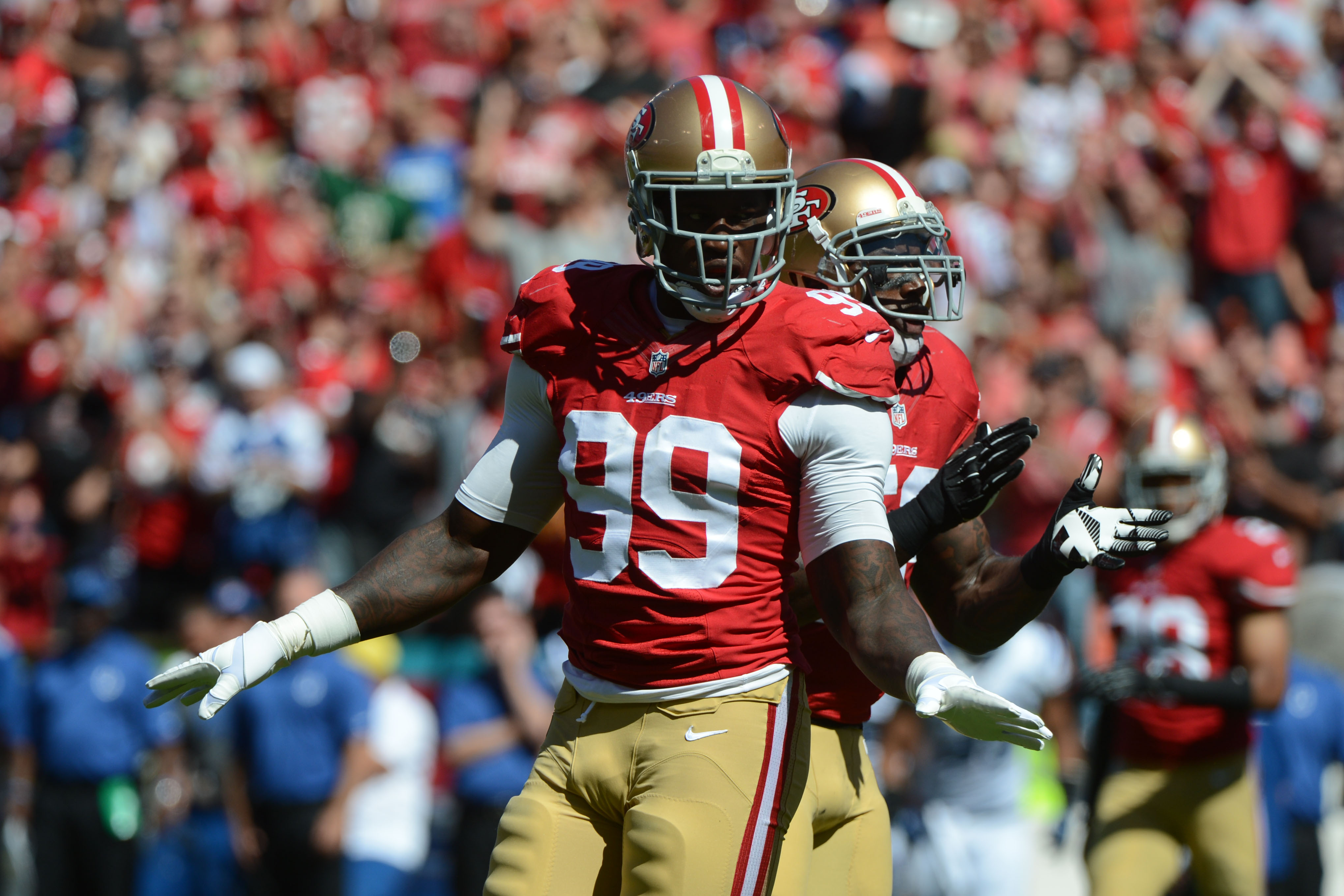 September 22, 2013; San Francisco, CA, USA; San Francisco 49ers outside linebacker Aldon Smith (99) celebrates after tackling Indianapolis Colts quarterback Andrew Luck (12, not pictured) during the first quarter at Candlestick Park. Mandatory Credit: Kyle Terada-USA TODAY Sports ORG XMIT: USATSI-132644 ORIG FILE ID:  20130922_kkt_st3_036.jpg