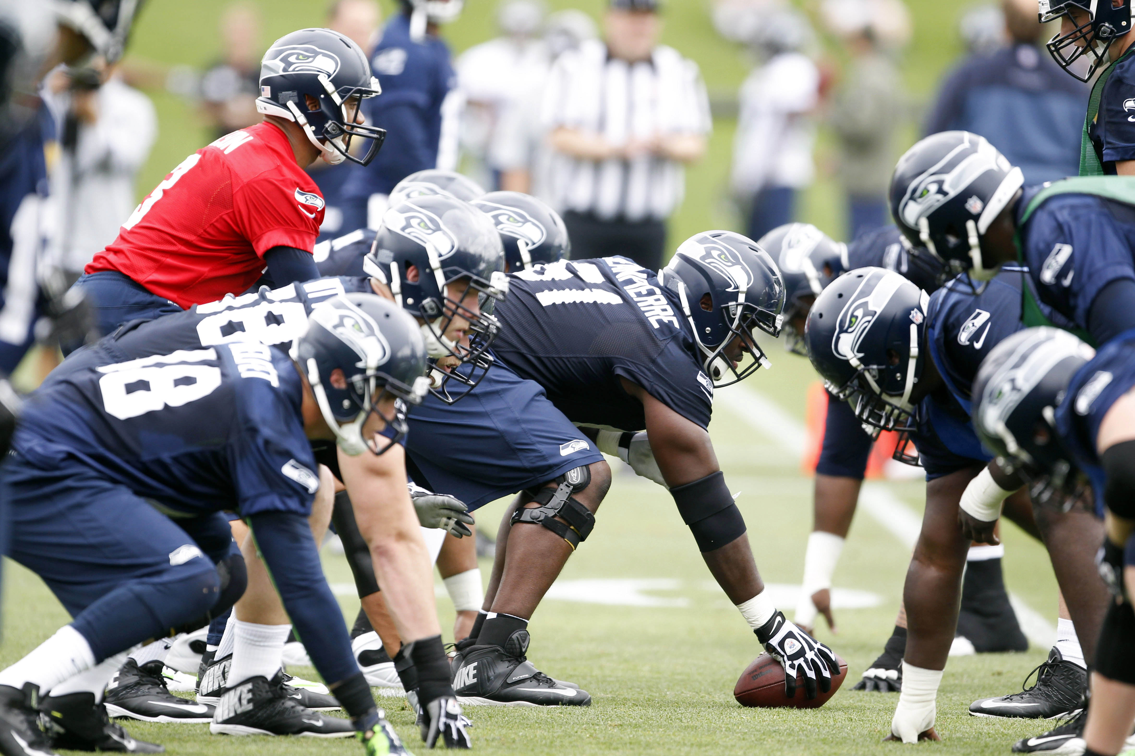 Jun 17, 2014; Renton, WA, USA; Seattle Seahawks quarterback Russell Wilson (3) stands over center for a scrimmage play during minicamp at the Virginia Mason Athletic Center. Mandatory Credit: Joe Nicholson-USA TODAY Sports