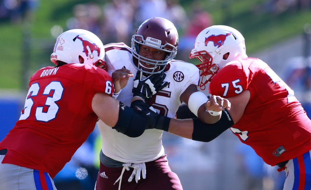 Texas A&M sophomore Myles Garrett battles two SMU defenders. (Tim Heitman / USA TODAY Sports)