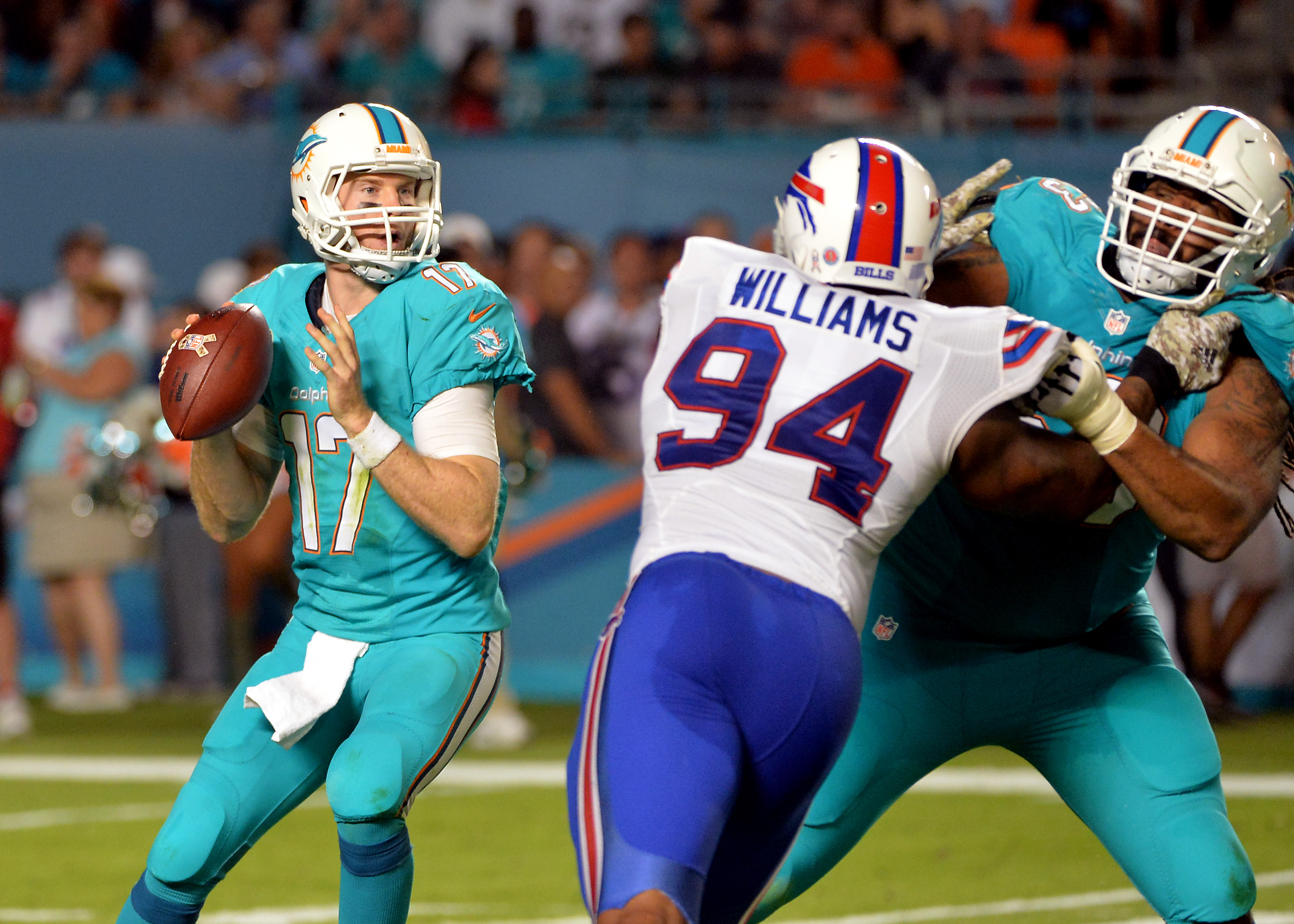Dolphins QB Ryan Tannehill (17) and Bills OLB Mario Williams (94) hope to emerge with a 2-1 record after their Sunday showdown.(Steve Mitchell, USA TODAY Sports)