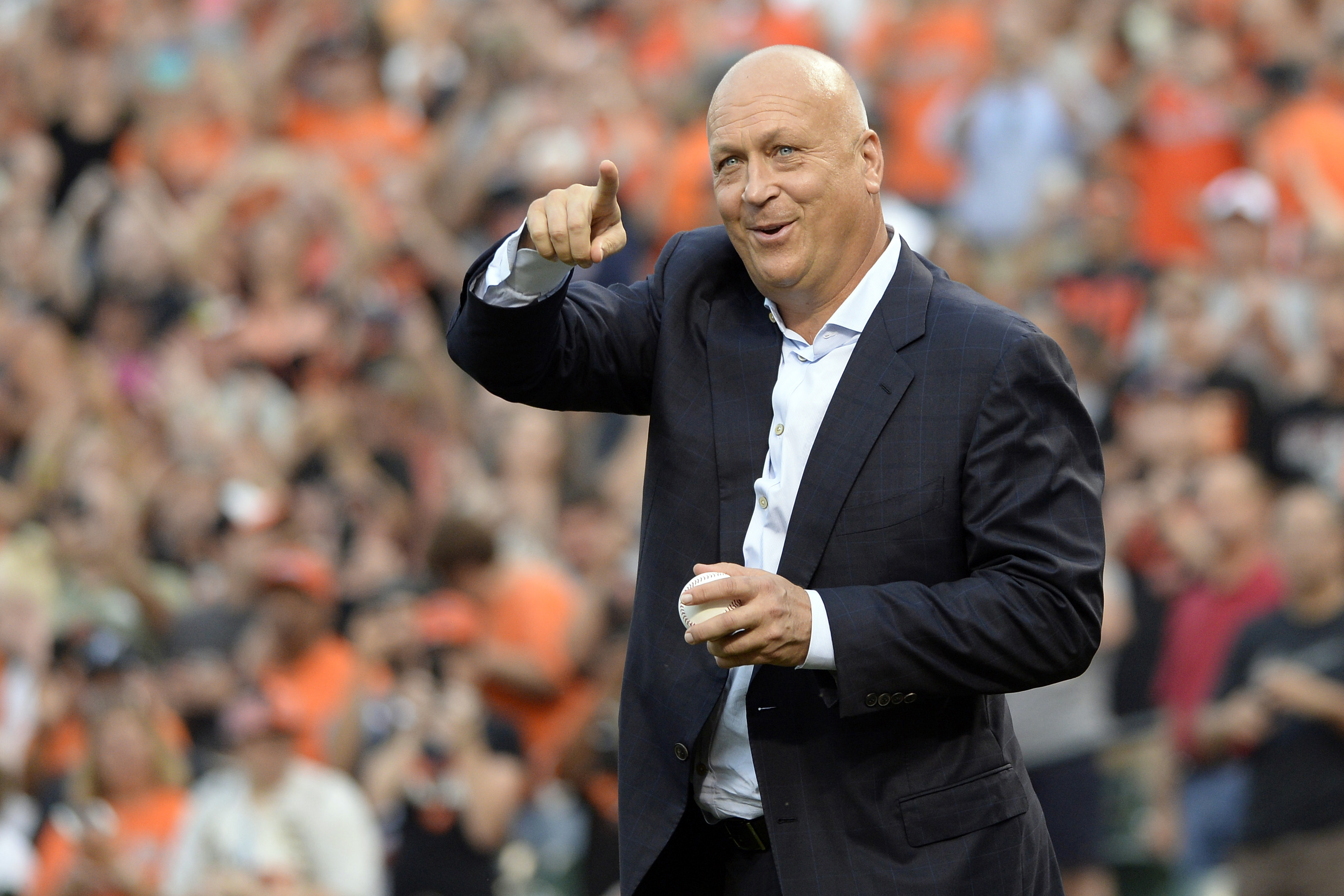 Sep 1, 2015; Baltimore, MD, USA; Baltimore Orioles former players Cal Ripken Jr. waves to the crowd before throwing out the first pitch on the 20th anniversary of breaking Lou Gehrig's 2131 consecutive games played streakbefore the game between the Baltimore Orioles and the Tampa Bay Rays at Oriole Park at Camden Yards. Mandatory Credit: Tommy Gilligan-USA TODAY Sports