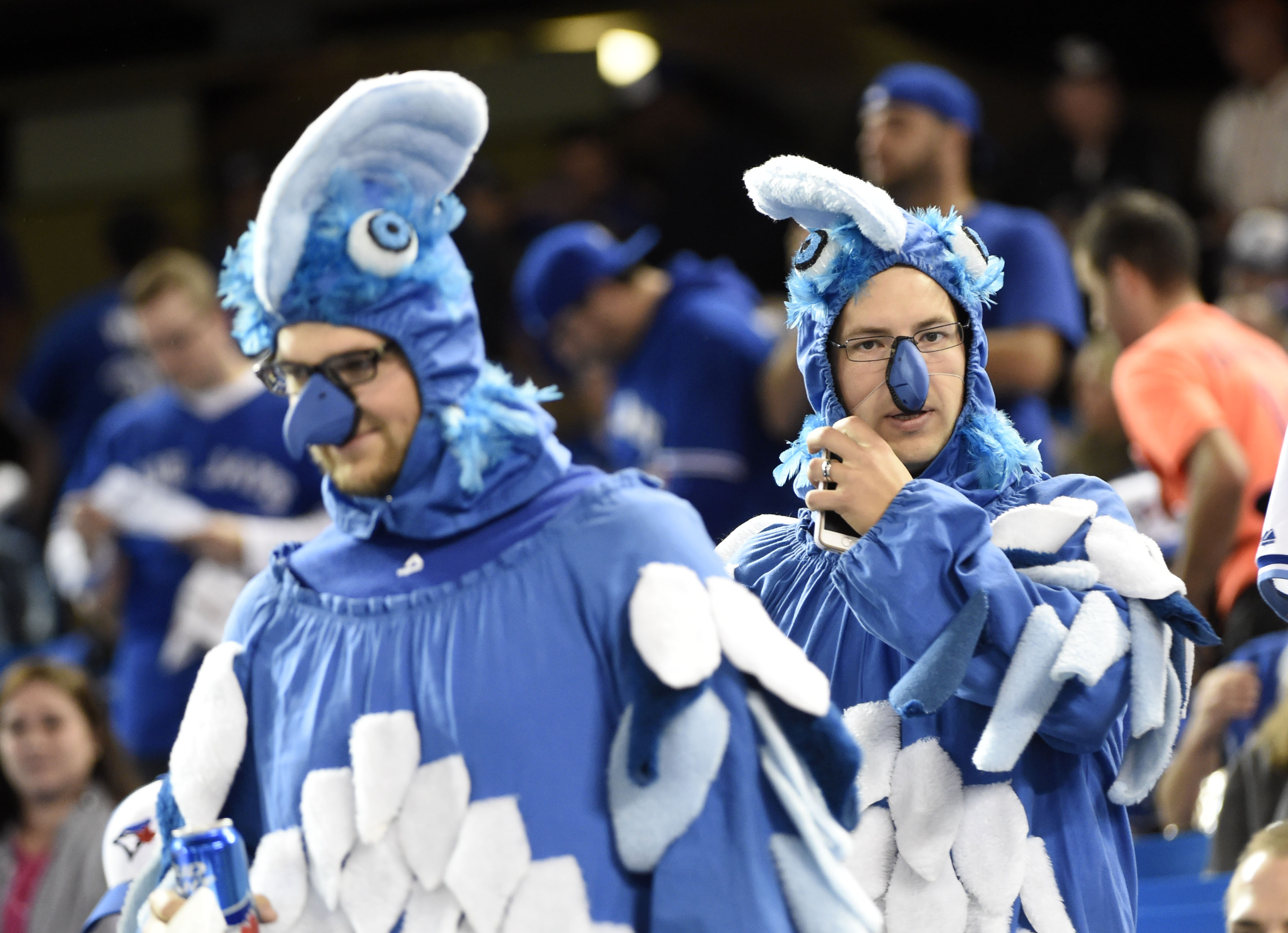 Toronto Blue Jays fans wear costumes before Game 5 of the ALDS against the Texas Rangers. (Photo: Nick Turchiaro, USA TODAY Sports)
