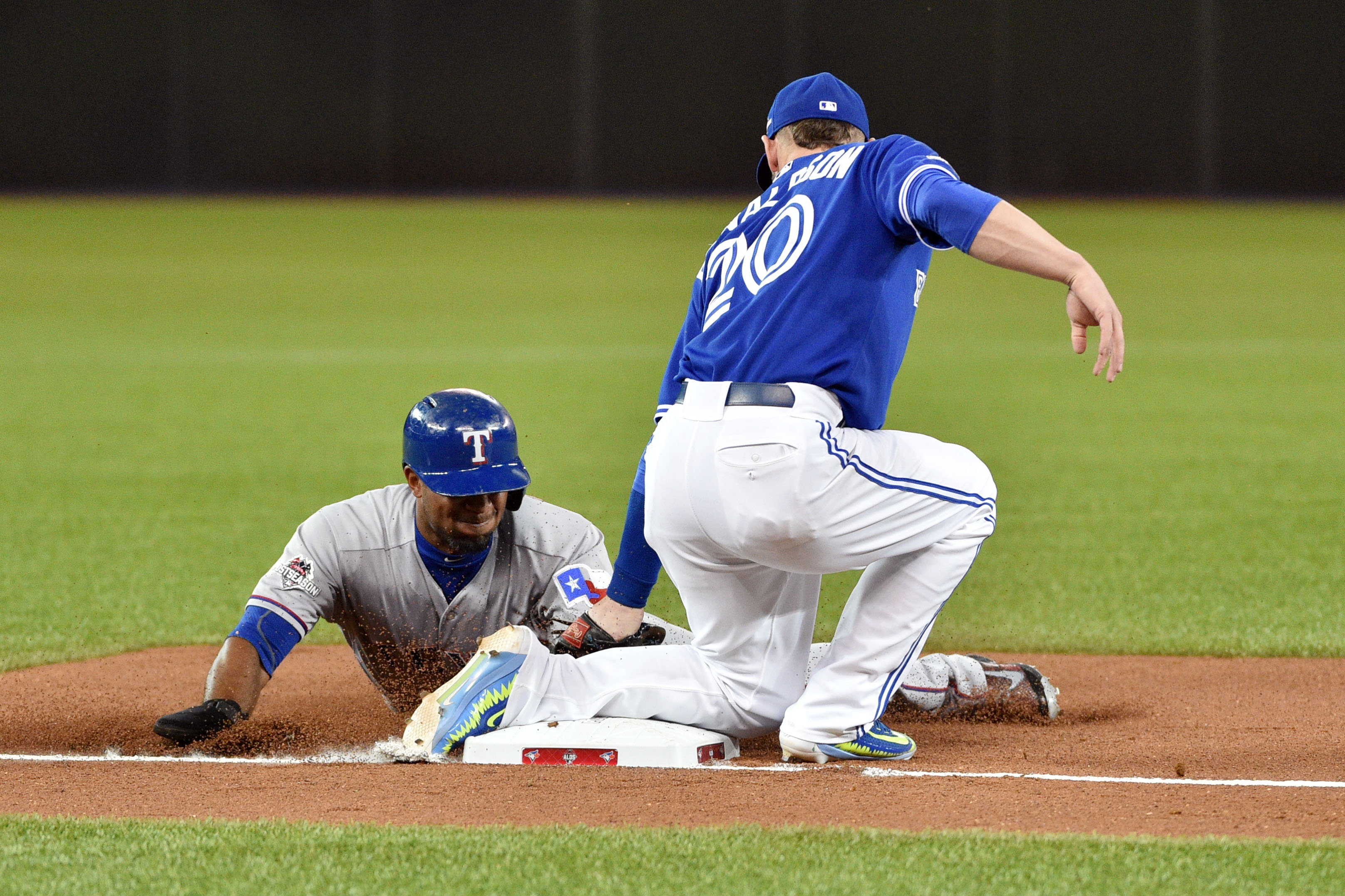 Rangers shortstop Elvis Andrus (left) is tagged out on a stolen base attempt by Blue Jays third baseman Josh Donaldson in the second inning. (Photo: Nick Turchiaro, USA TODAY Sports)