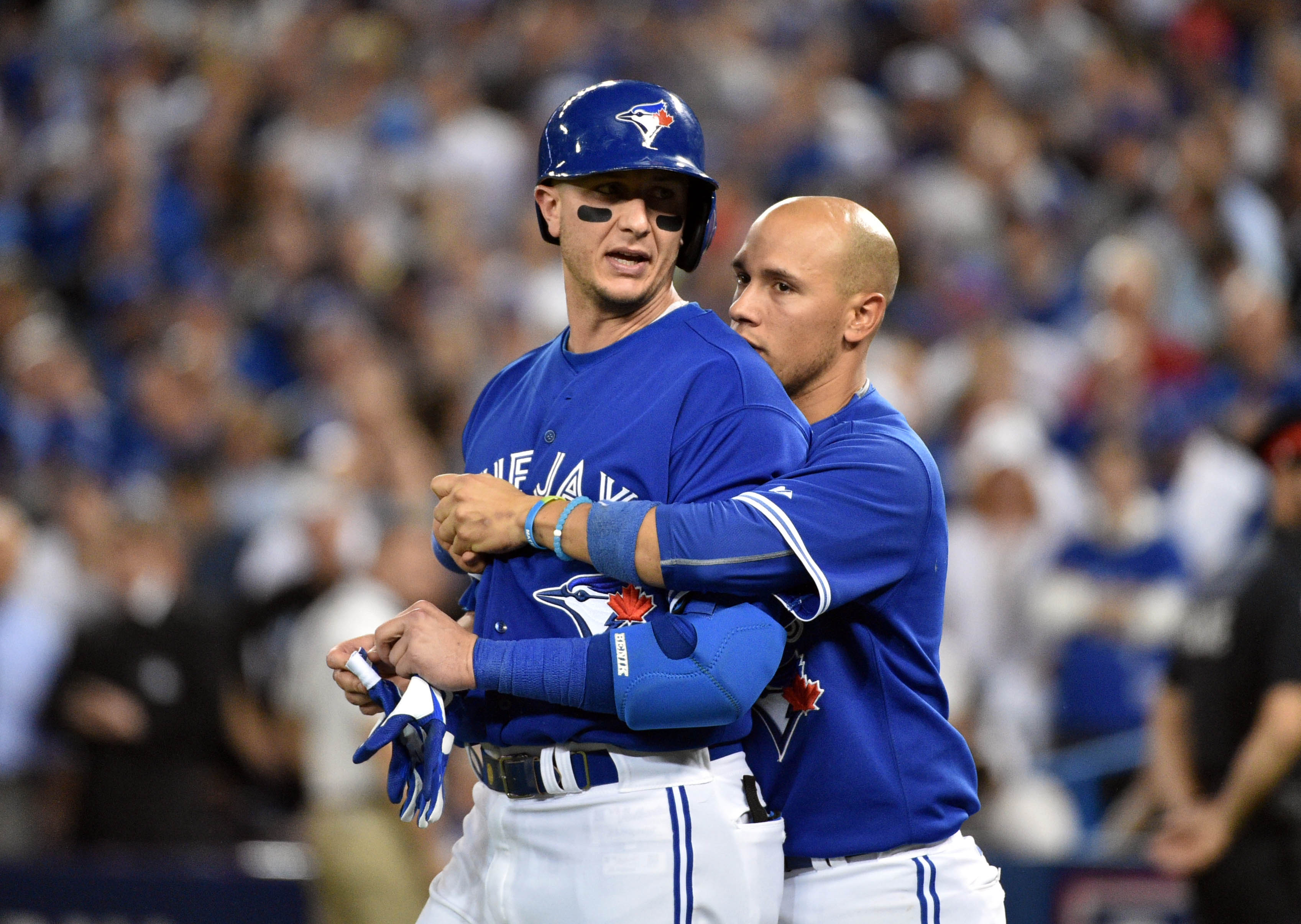 Blue Jays shortstop Troy Tulowitzki (left) is restrained by a teammate as the benches clear following a wild 7th inning. (Photo: Nick Turchiaro, USA TODAY Sports)
