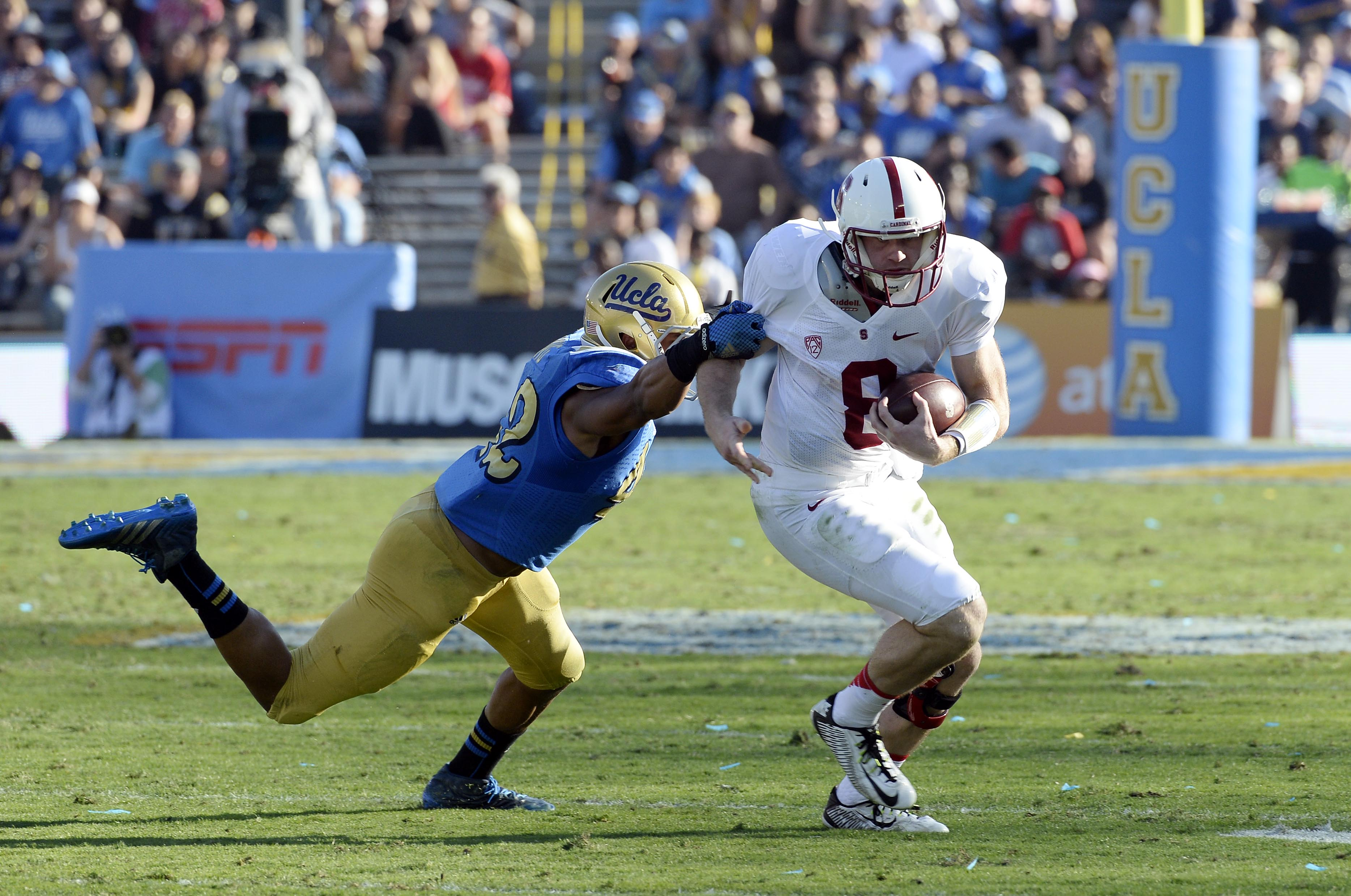 UCLA must try to slow down Stanford quarterback Kevin Hogan (Richard Mackson, USA TODAY Sports)