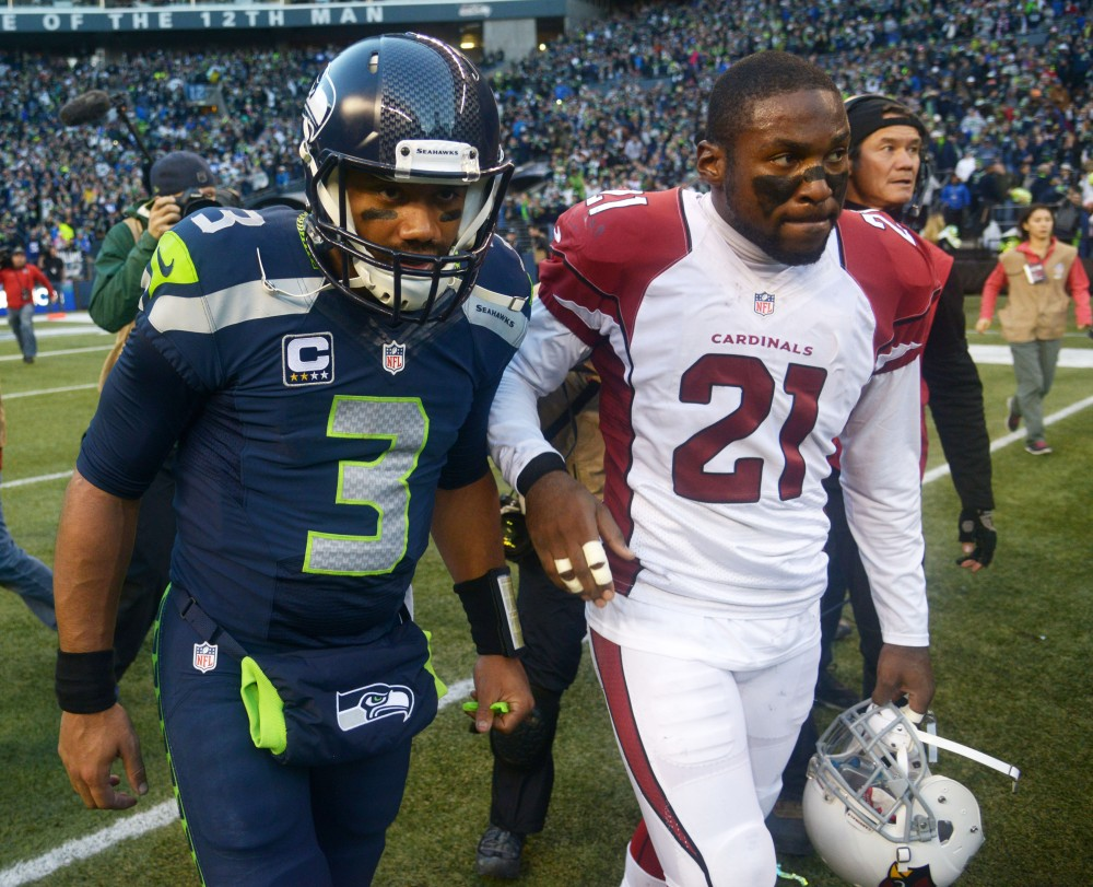 Patrick Peterson's Cardinals have already proven they can beat Russell Wilson (3) and the Seahawks in Seattle. (Kirby Lee, USA TODAY Sports)