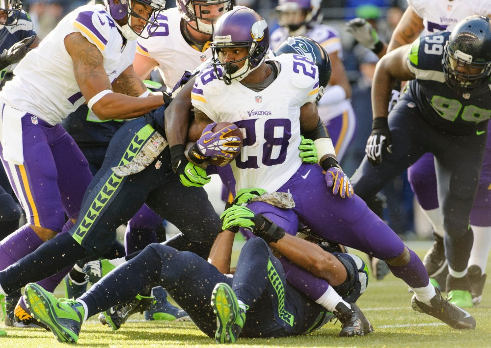 Vikings RB Adrian Peterson will try to add to his NFL rushing lead against the Seahawks. (Steven Bisig, USA TODAY Sports)
