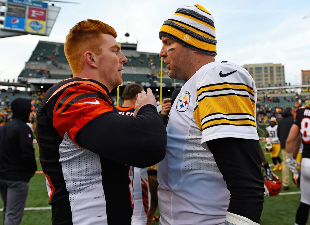 Andy Dalton, left, and the Cincinnati Bengals will win the AFC North on Sunday by beating Ben Roethlisberger's Pittsburgh Steelers. (Mike DiNovo, USA TODAY Sports)