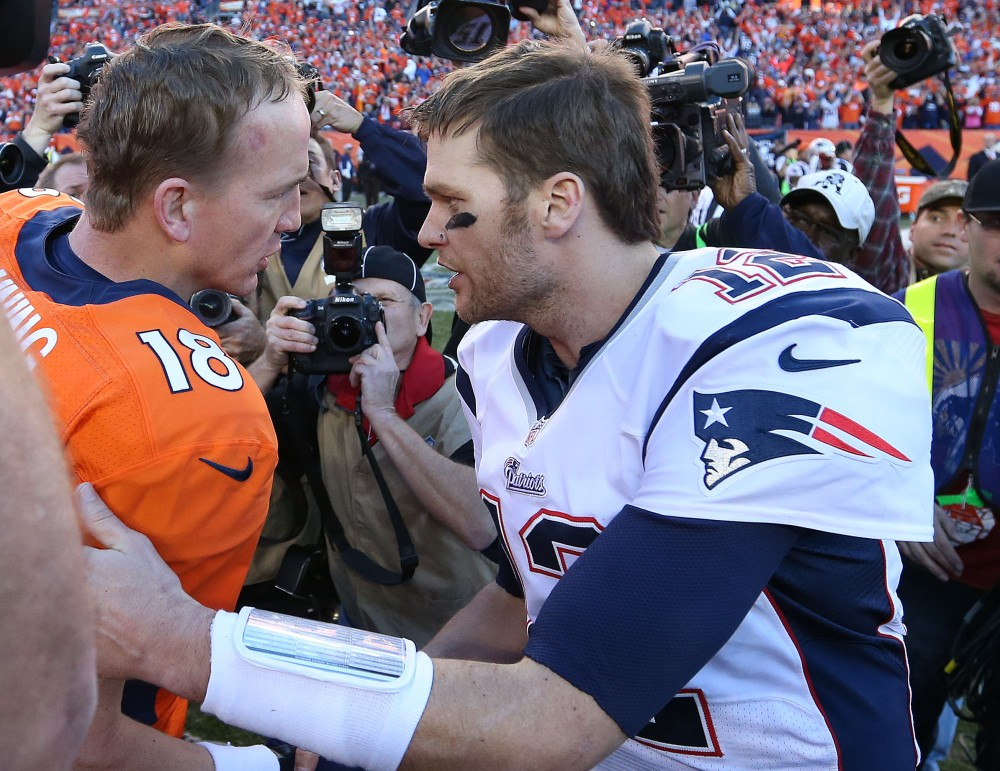 Peyton Manning (18) hopes to run his record against Tom Brady in championship games to 3-1 Sunday. (Matthew Emmons, USA TODAY Sports)