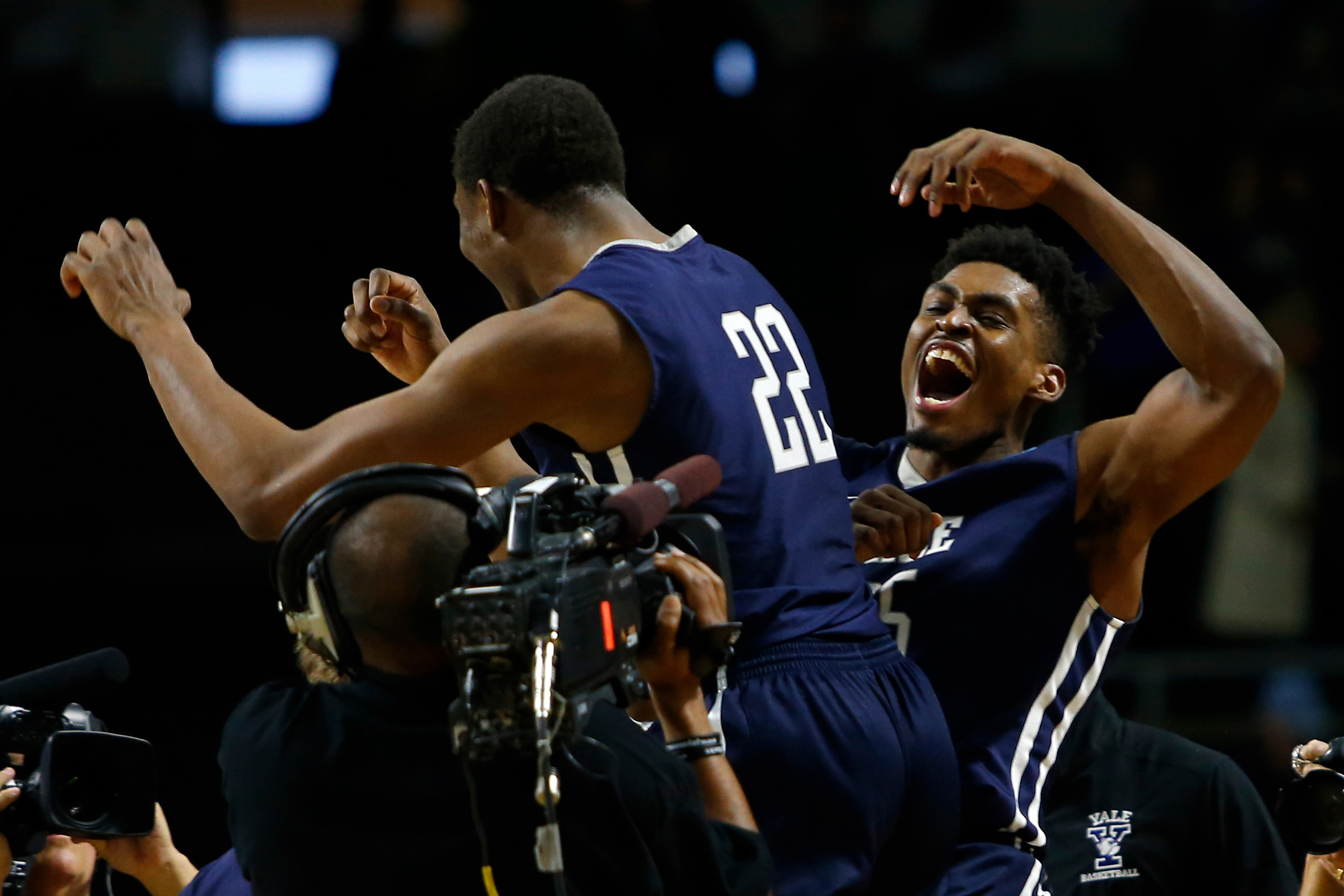 Mar 17, 2016; Providence, RI, USA; Yale Bulldogs forward Justin Sears (22) and Brandon Sherrod (35) celebrate their victory over Baylor during a first round game of the 2016 NCAA Tournament at Dunkin Donuts Center. Mandatory Credit: Winslow Townson-USA TODAY Sports