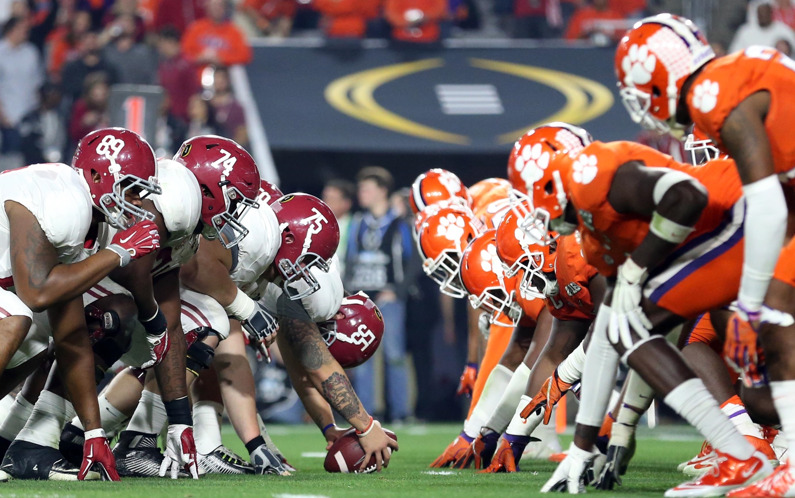 Jan 11, 2016; Glendale, AZ, USA; Alabama Crimson Tide and Clemson Tigers players line up before a snap in the third quarter in the 2016 CFP National Championship at University of Phoenix Stadium. Mandatory Credit: Mark J. Rebilas-USA TODAY Sports