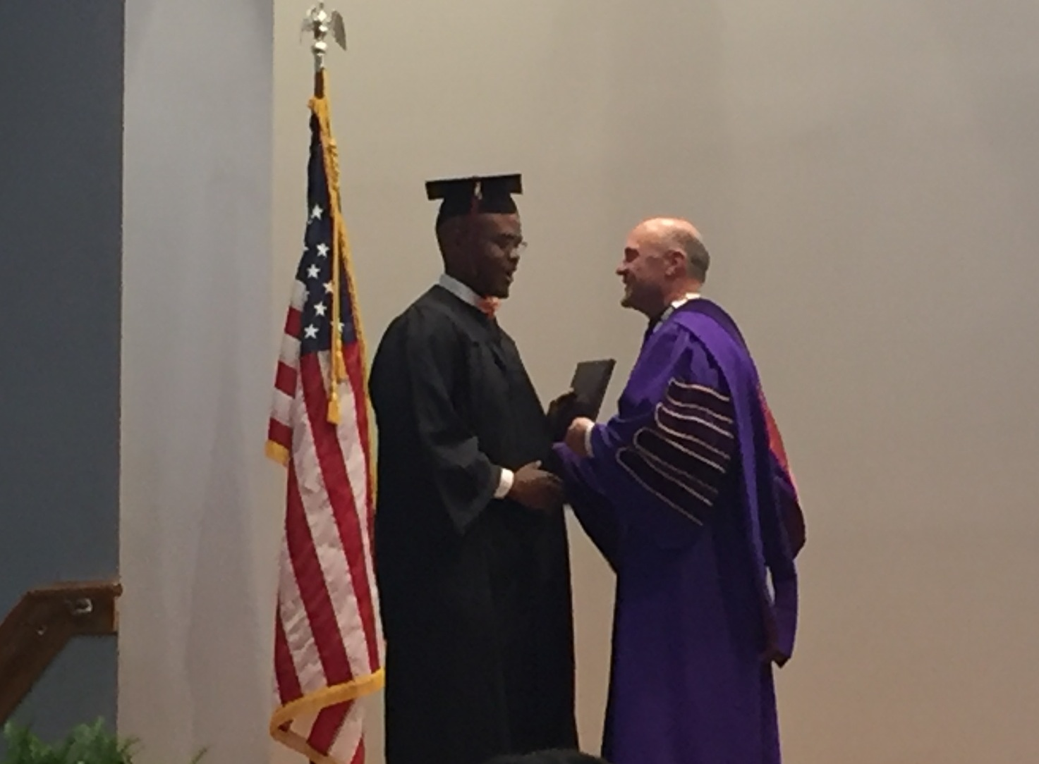 Steven Fleming accepts his certificate from President Clements.