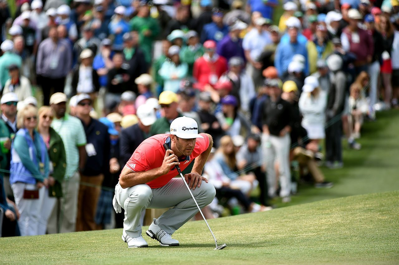 Dustin Johnson lines up a putt on the second green during the final round of the 2016 Masters Tournament at Augusta National Golf Club.
