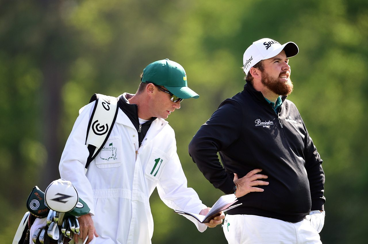 Shane Lowry and his caddie caddie Dermot Byrne prepare to play a shot from the 12th tee during a practice round prior to the start of the 2016 Masters Tournament at Augusta National Golf Club.