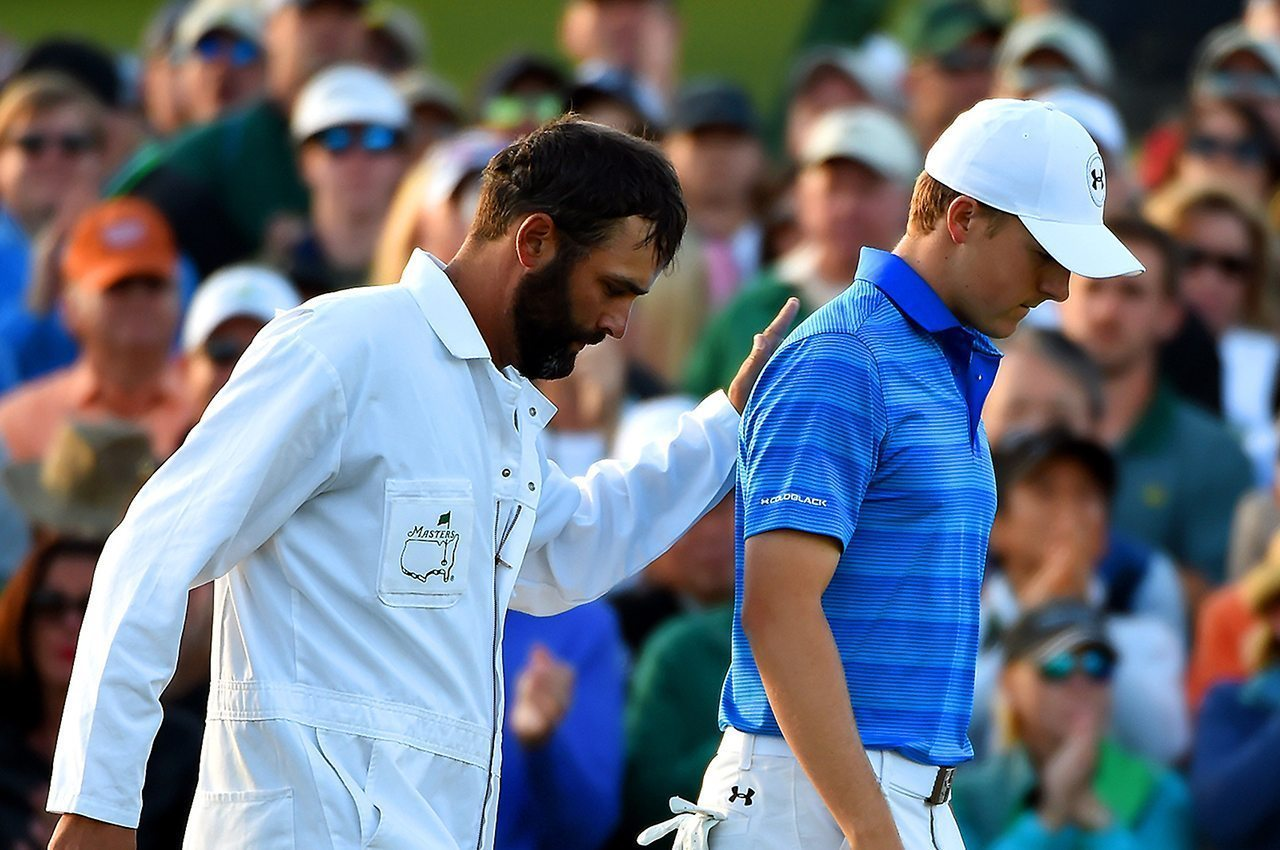 Jordan Spieth and his caddie Michael Greller after Spieth failed to win a second straight Masters title.
