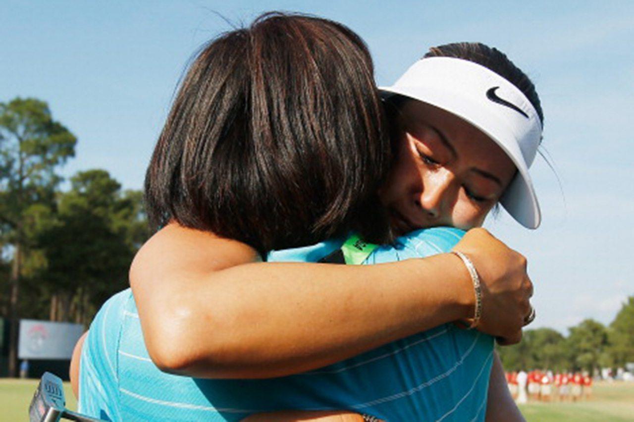 Michelle Wie hugs her mother Bo after winning the 2014 U.S. Open.