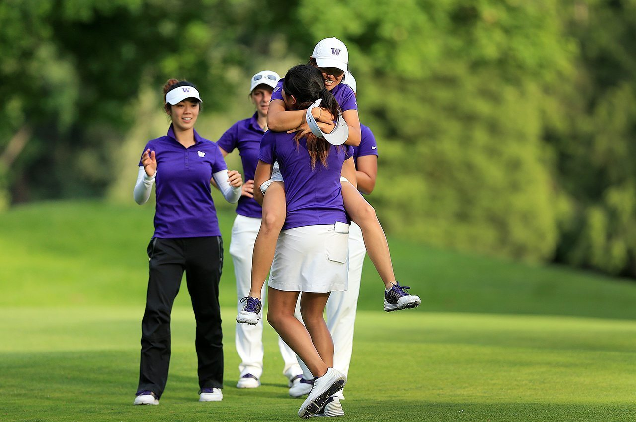 Washington Huskies celebrate their win over UCLA during the semifinals of the NCAA Women's Championship.