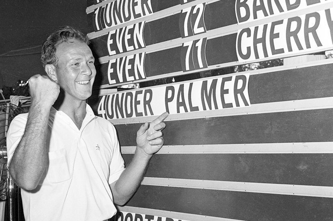 Arnold Palmer points to his name on the press ten scoreboard showing his four under par total for 72 holes for the National Open tournament in Denver, Colo., June 19, 1960. Palmer won the tournament with a score of 280. (AP Photo)