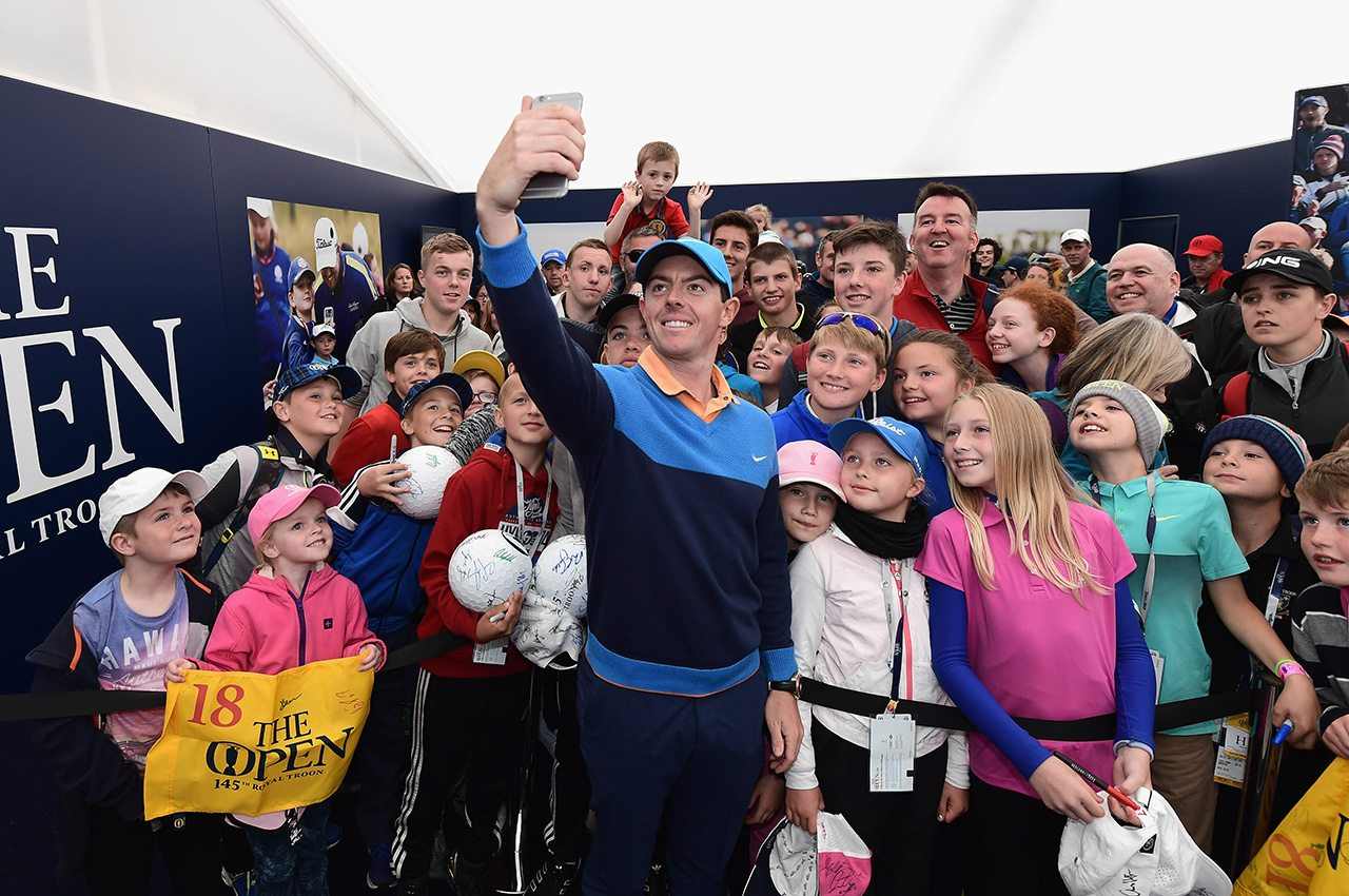 Rory McIlroy, shown with fans at the 2016 British Open