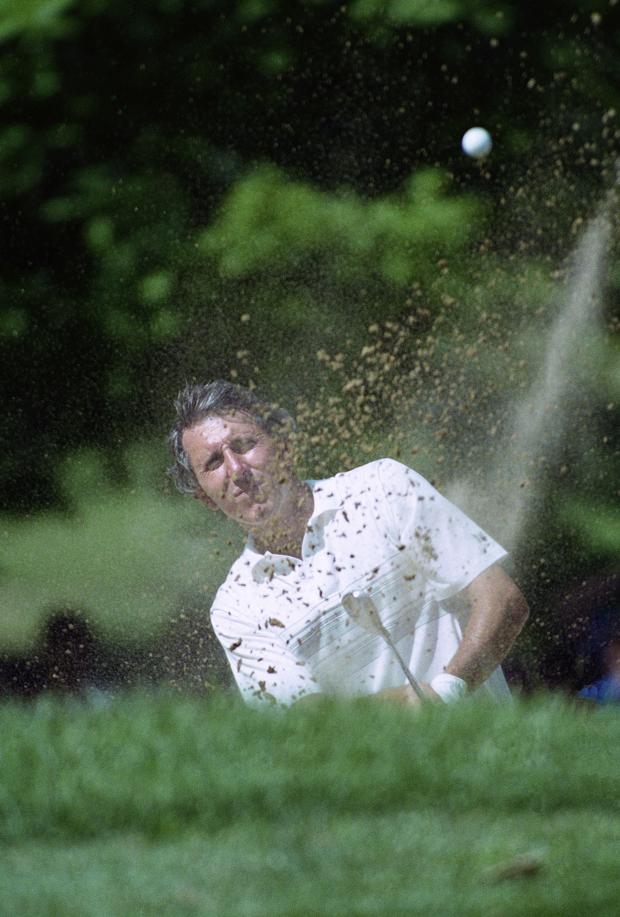 Hale Irwin blasts out of a trap on the 14th hole at Medinah Country Club on June 19, 1990 during his US Open playoff with Mike Donald. The two golfers ended up tied after 18 playoff holes and Irwin birdied the 1st sudden death hole to give him his third Open title.