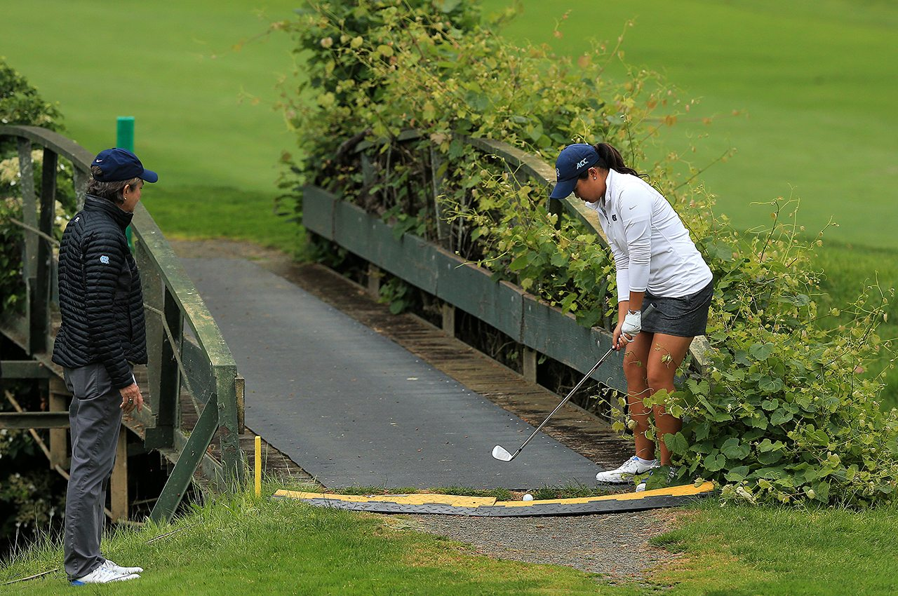 UNC's Bryana Nguyen takes a 10 on the 15th hole after her ball landed on the bridge on Friday at the Women's NCAA Championships at Eugene Country Club.
