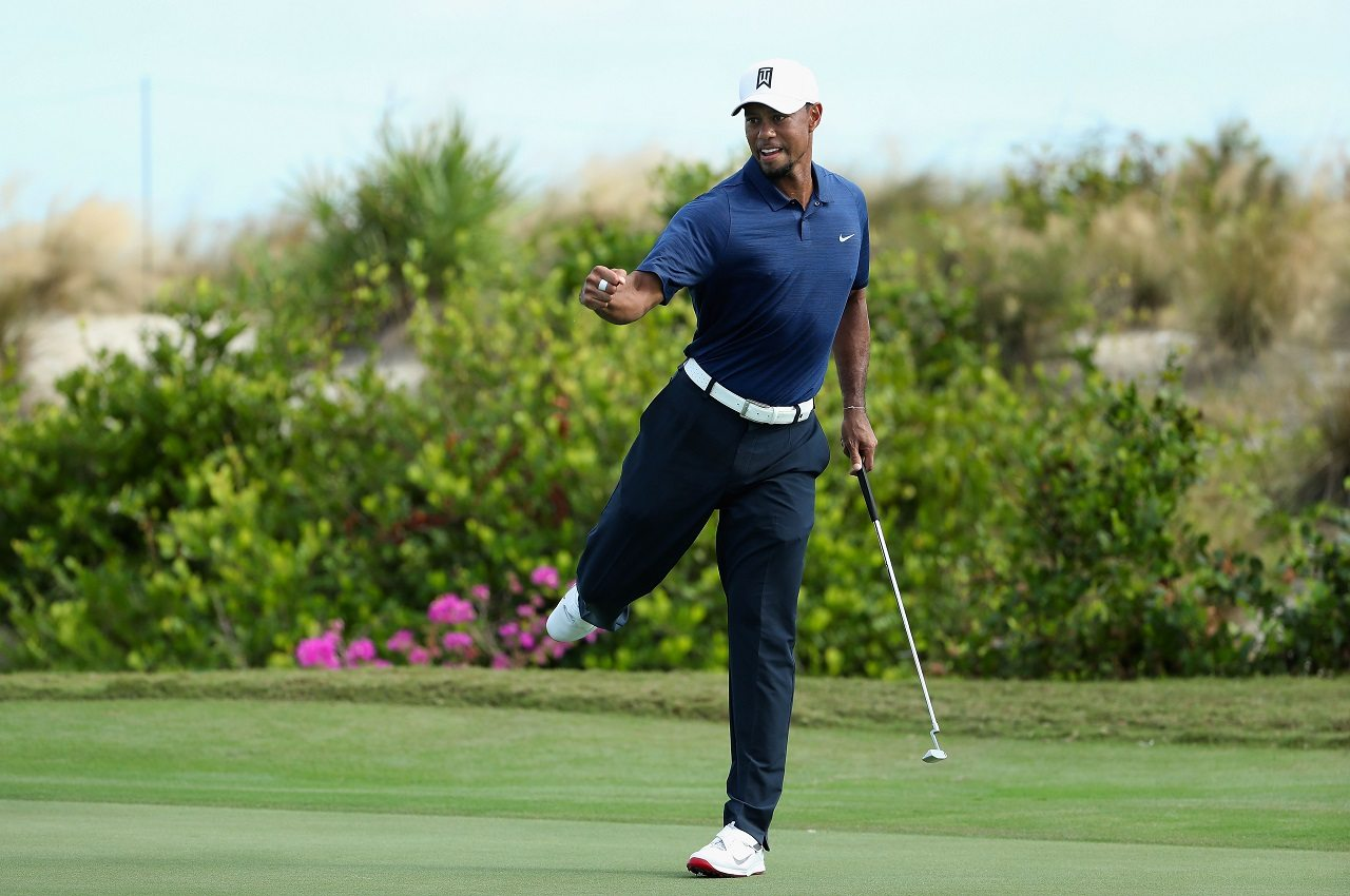 Tiger Woods celebrates a birdie putt during Round 2 of the Hero World Challenge. (Getty Images)