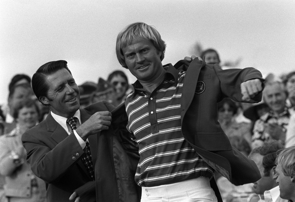 Gary Player, left, defending Masters champion, puts the green jacket on Jack Nicklaus, April 13, 1975, at Augusta National golf club. (GETTY IMAGES)