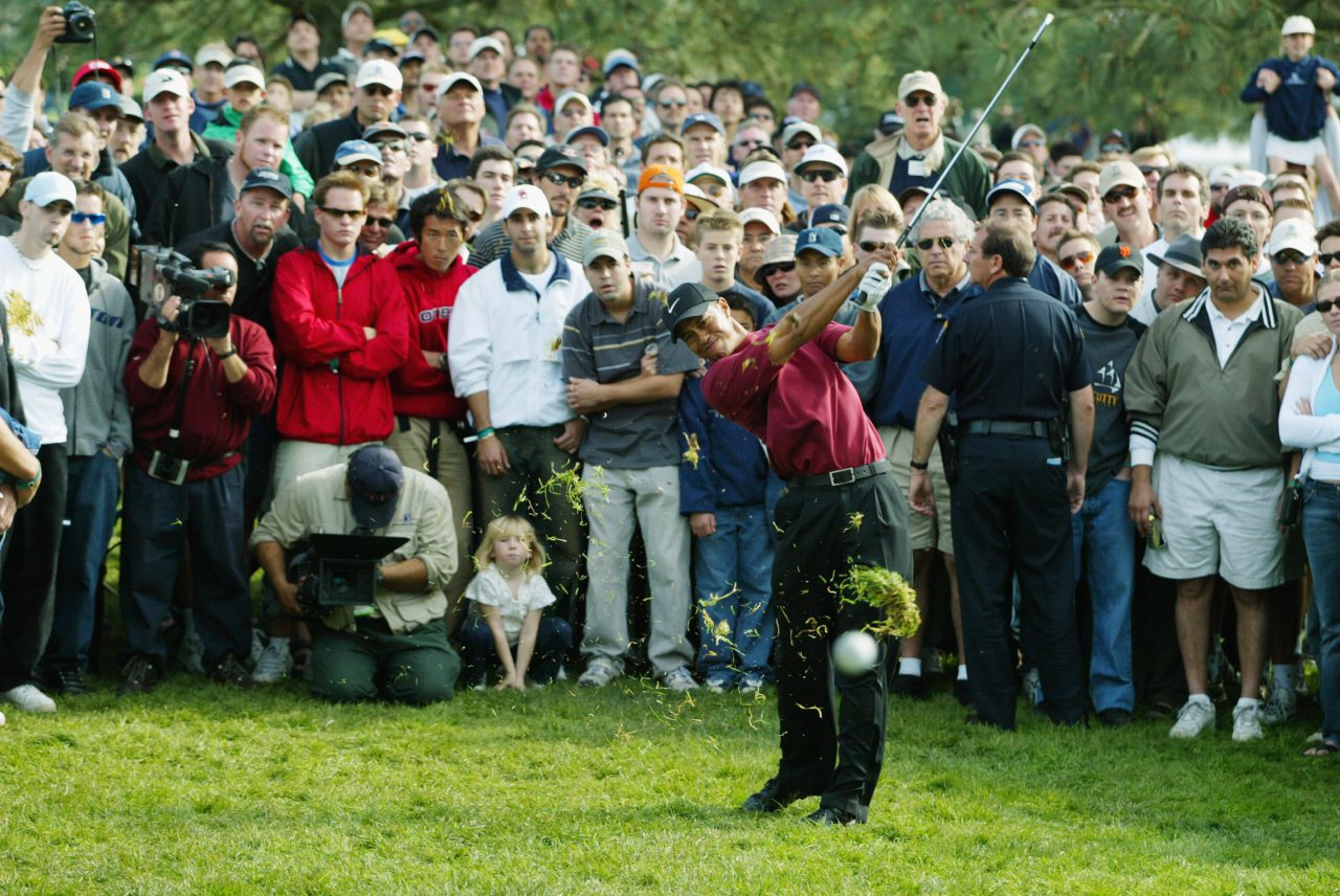 SAN DIEGO, CA - FEBRUARY 16: Tiger Woods hits out of the heavy rough on the 17th hole during the final round at the Buick Invitational at Torrey Pines Golf Course on February 16, 2003 in La Jolla, California. (Photo by Donald Miralle/Getty Images)