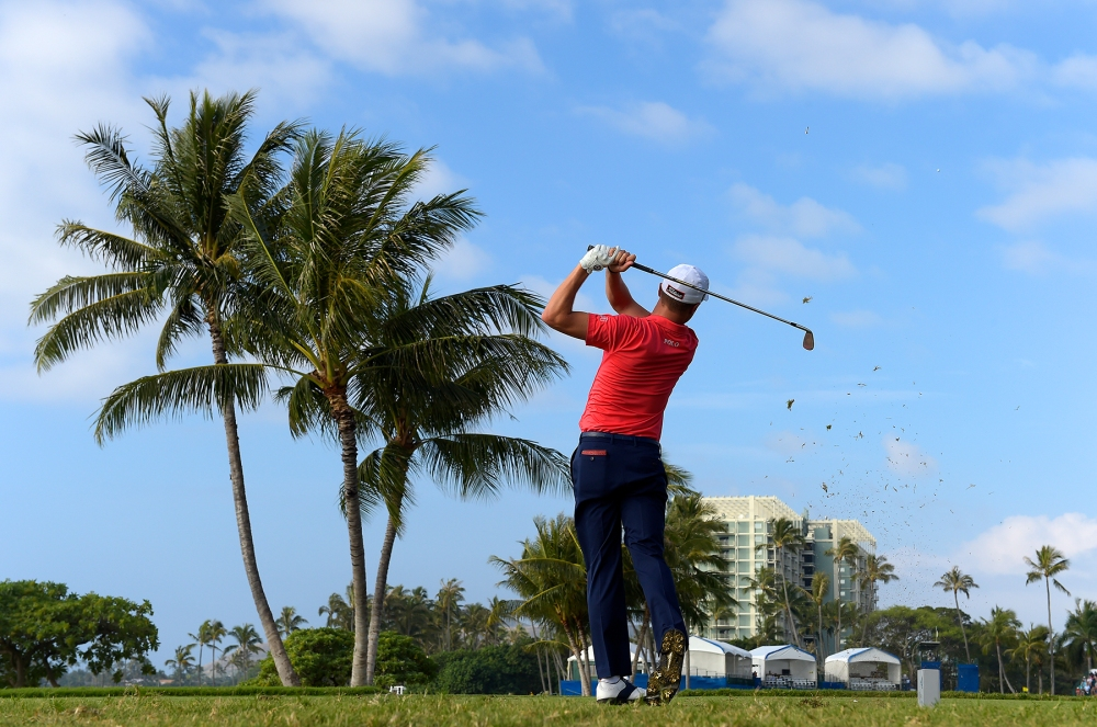 HONOLULU, HI - JANUARY 12: Justin Thomas plays a tee shot on the 17th hole during the first round of the Sony Open in Honolulu, Hawaii at Waialae Country Club on January 12, 2017 in Honolulu, Hawaii. (Photo by Stan Badz/PGA TOUR)