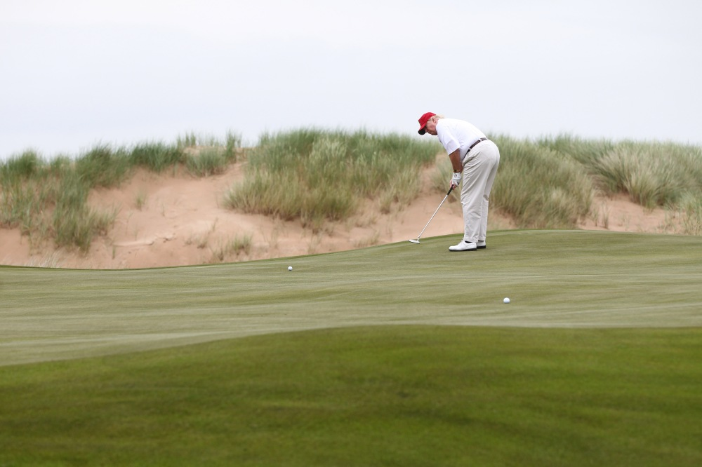 Donald Trump plays Trump International Golf Links in Scotland in 2012. (GETTY IMAGES)