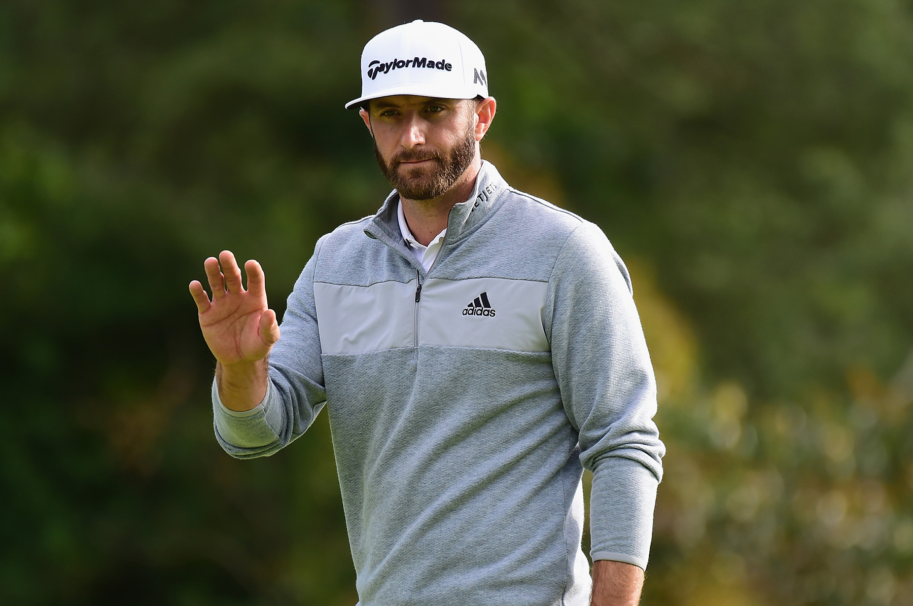 PACIFIC PALISADES, CA - FEBRUARY 19: Dustin Johnson reacts to his putt on the 12th hole during the final round at the Genesis Open at Riviera Country Club on February 19, 2017 in Pacific Palisades, California. (Photo by Harry How/Getty Images)