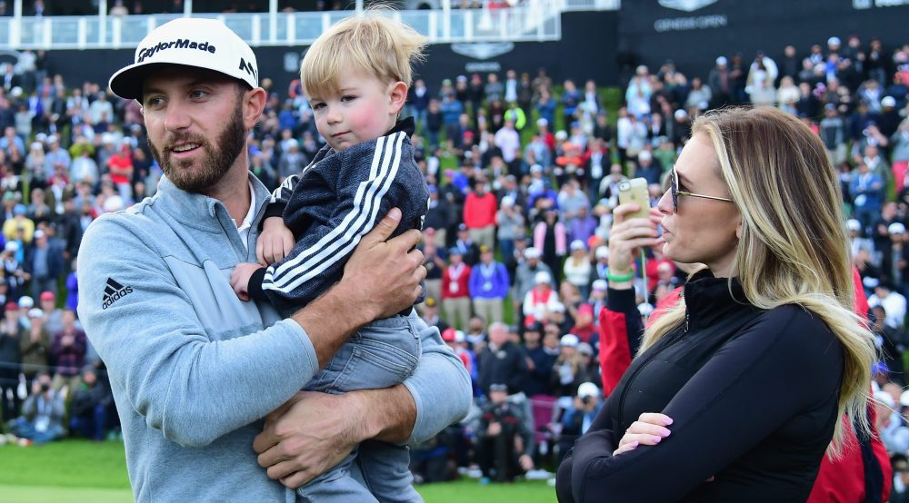 PACIFIC PALISADES, CA - FEBRUARY 19: Dustin Johnson celebrates his win with wife Paulina Gretzky and son Tatum on the 18th green during the final round at the Genesis Open at Riviera Country Club on February 19, 2017 in Pacific Palisades, California. (Photo by Harry How/Getty Images)