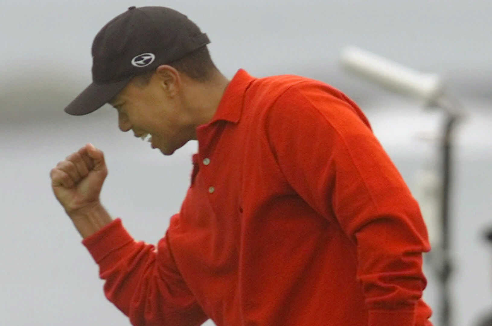 Tiger Woods of Orlando, Fla., reacts on the 18th green of the Pebble Beach Golf Links after making a birdie putt to take the lead and win the AT&T Pebble Beach National Pro-Am in Pebble Beach, Calif., Monday Feb. 7, 2000. The win was Woods' sixth consecutive PGA Tour victory.(AP Photo/Eric Risberg)